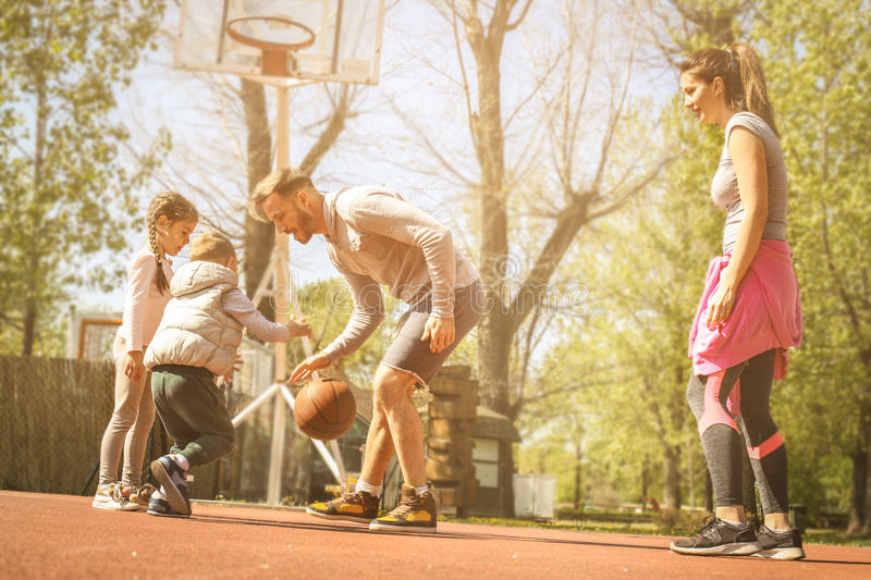 Family playing basketball. Caucasian family playing basketball together royalty free stock images