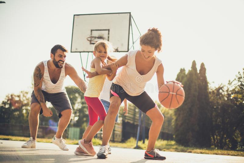 Family playing basketball together. On the move stock photo