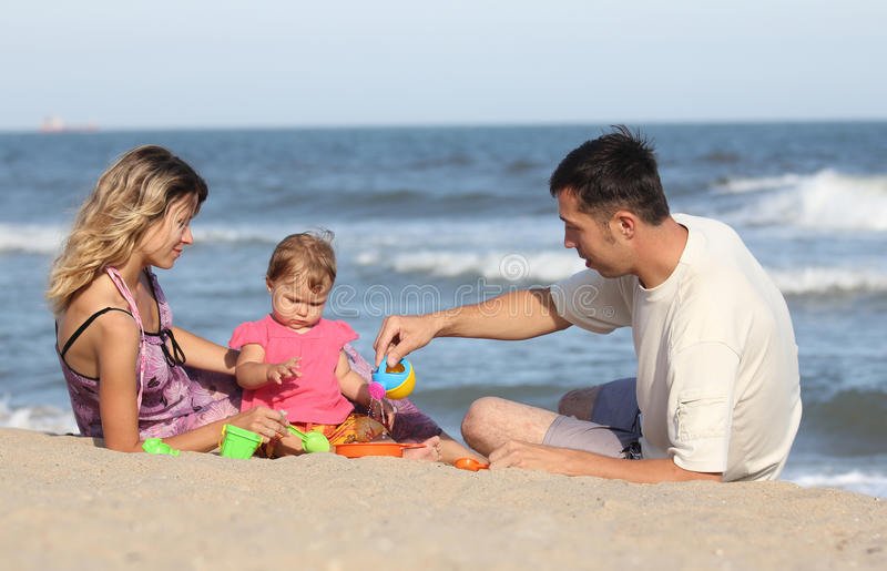 Download Family Playing On The Beach Royalty Free Stock Photo - Image: 15968575