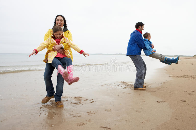Family playing on beach royalty free stock photos