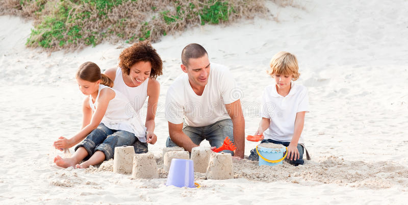Family playing on a beach royalty free stock photos