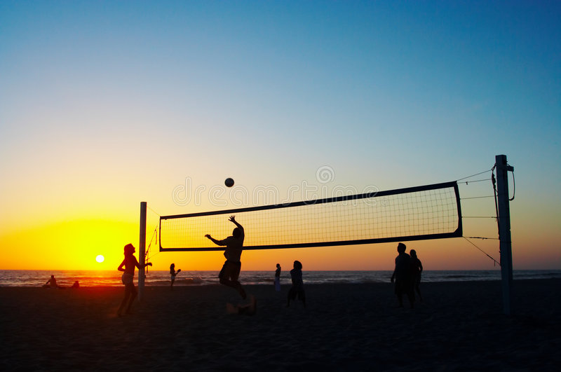 Family playing beach volleyball royalty free stock photography