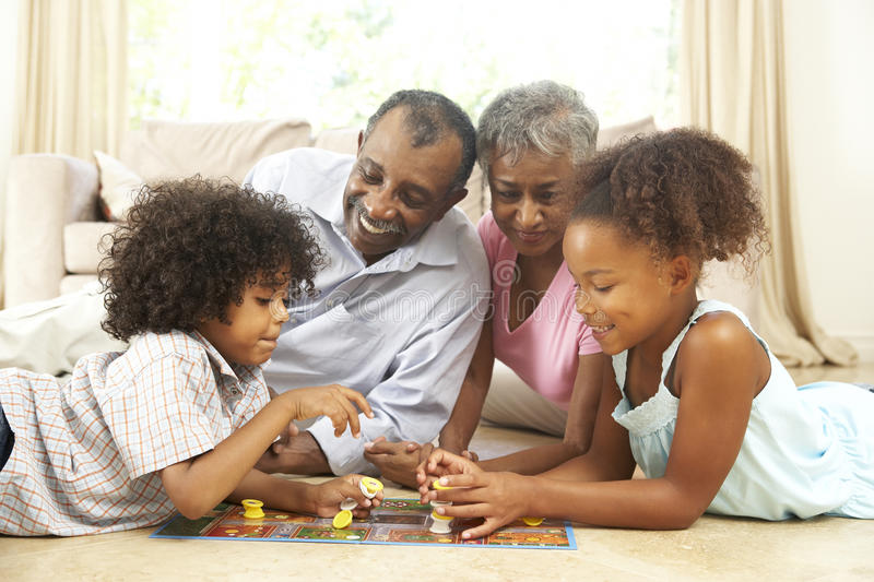 Download Family Playing Board Game At Home Stock Photo - Image of quarter, people: 11502352