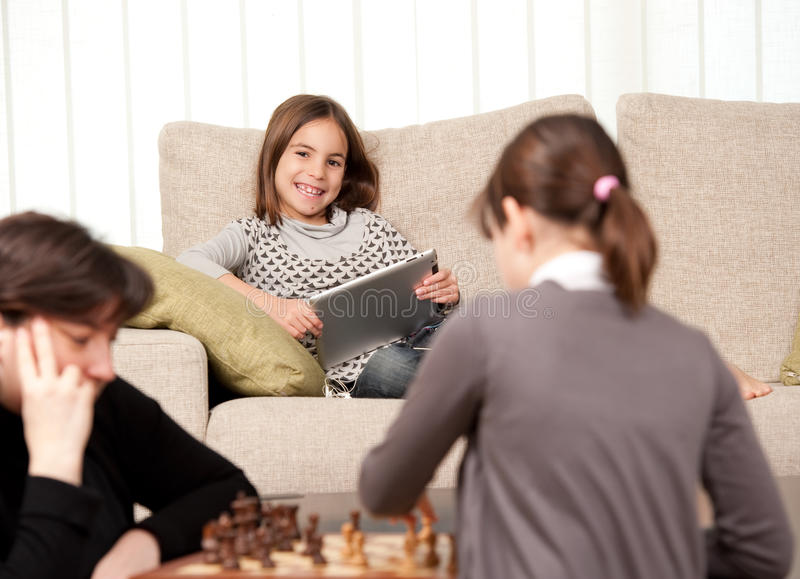 Family playing chess royalty free stock image