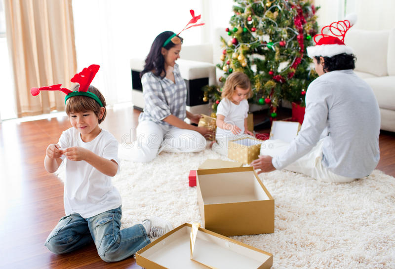 Download Family Playing With Christmas Gifts At Home Stock Image - Image: 11943275