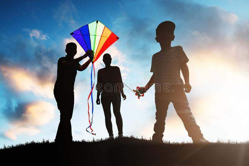 Family Playing With The Colorful Kite stock photos
