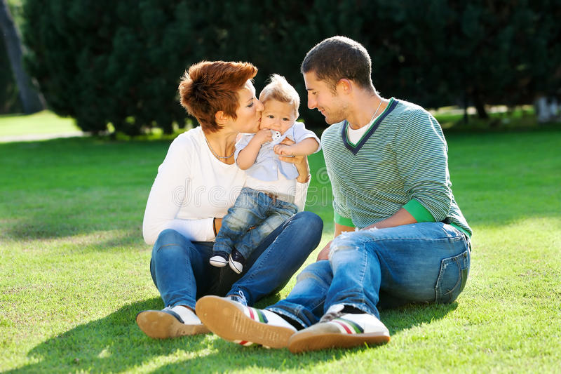 Family playing on grass royalty free stock images