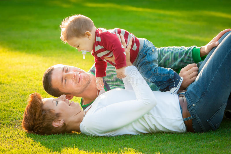 Family playing on grass stock image