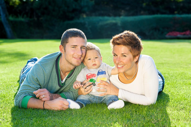 Family playing on grass royalty free stock image