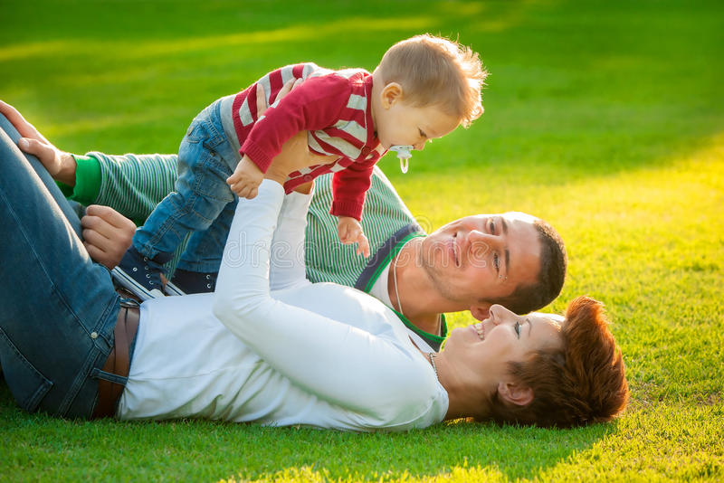 Family playing on grass royalty free stock photos
