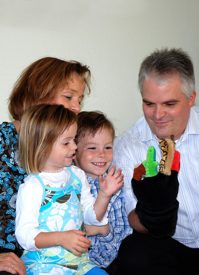 Family playing with hand puppets stock photos