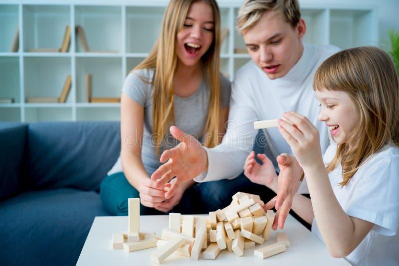 Family playing Jenga stock photo