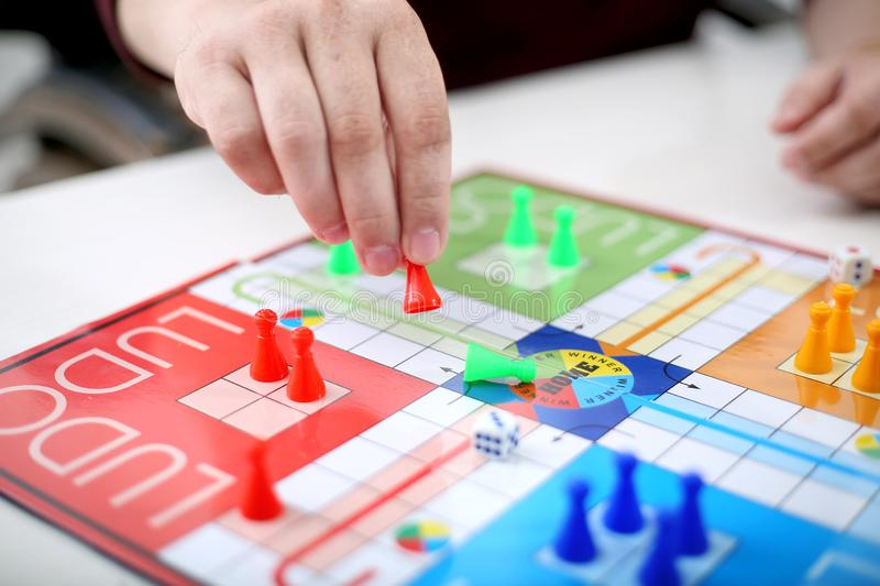Family playing ludo game royalty free stock photo
