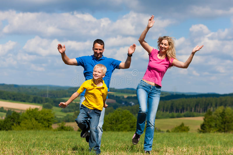 Family playing on meadow in summer stock image