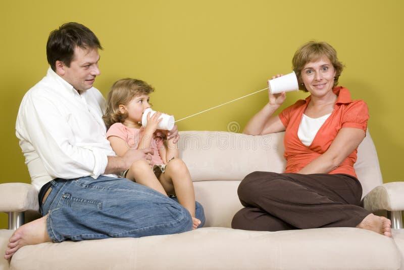 Download Family Playing With Mug Phone Stock Image - Image: 6551433