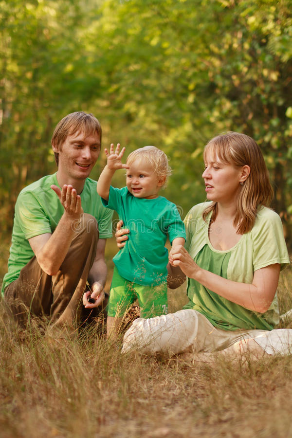 Family playing in nature stock image