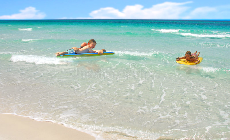 Download Family Playing In Ocean Surf Stock Image - Image: 5770119