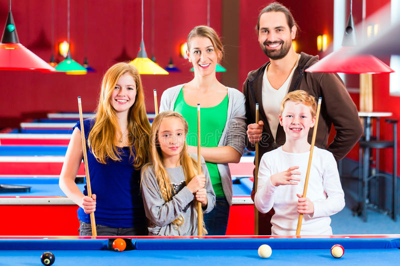 Family Playing Pool Billiard Game Stock Images
