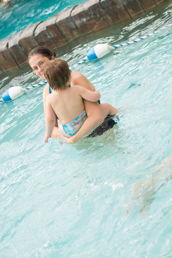 Download Family playing in the pool stock photo. Image of child - 30509174
