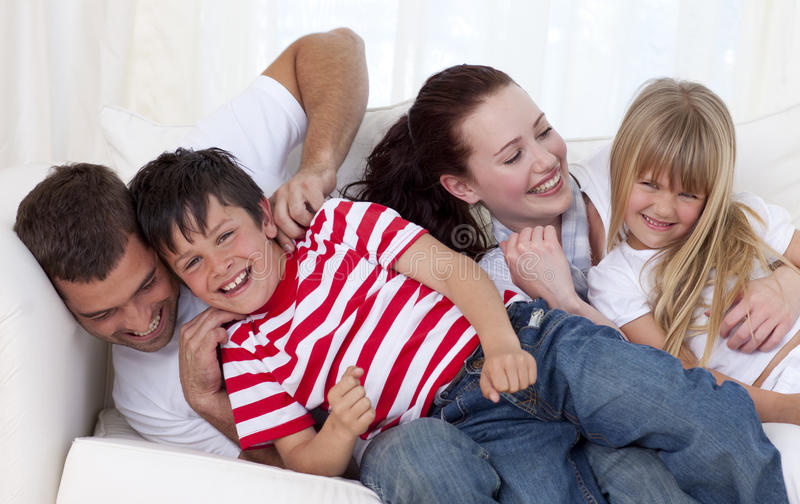 Family Playing On Sofa Together Stock Image - Image of brother ...
