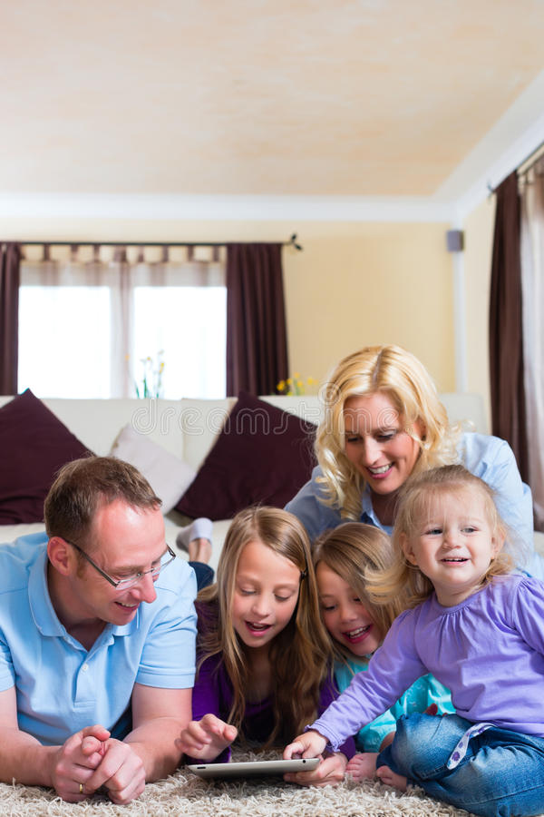 Family Playing With Tablet Computer At Home Stock Photography