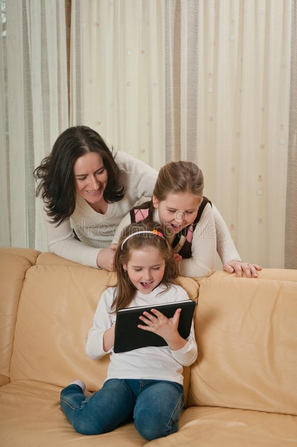 Family Playing With Tablet At Home Stock Photography