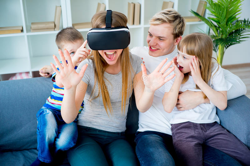 Family playing with virtual reality royalty free stock photo