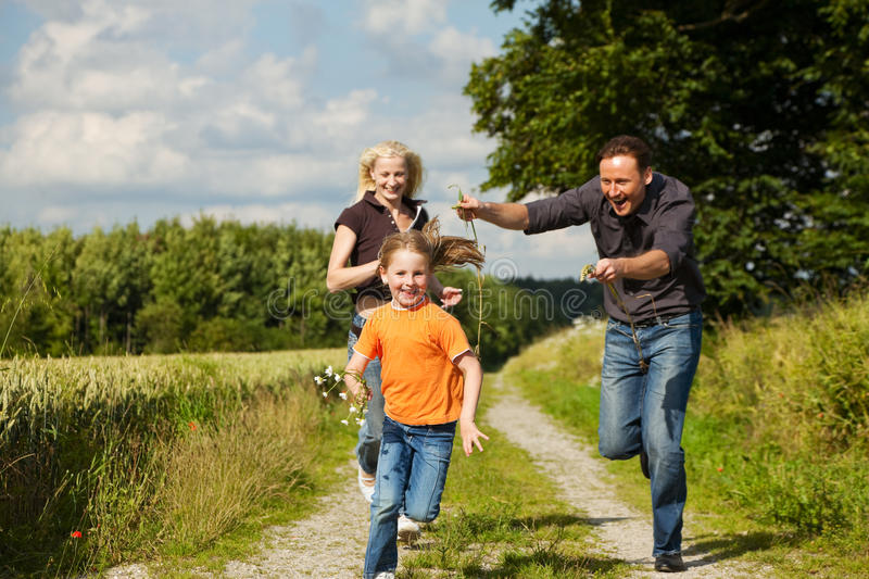 Family playing at a walk stock photo