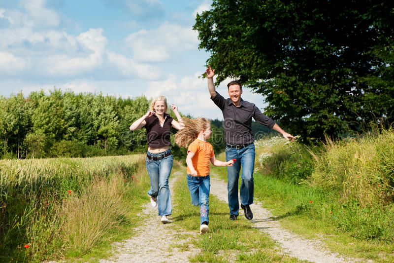 Family playing at a walk royalty free stock image