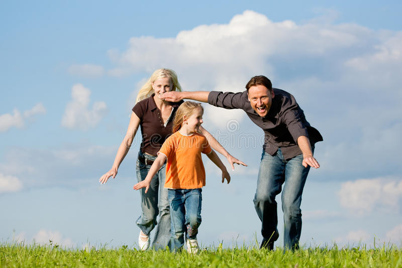 Family playing at a walk stock image