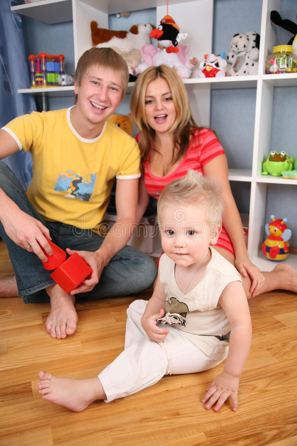 Family in playroom. The family of three in playroom royalty free stock photo