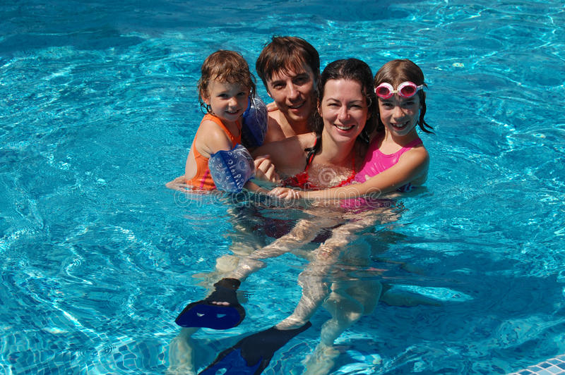 Family in the pool stock photos