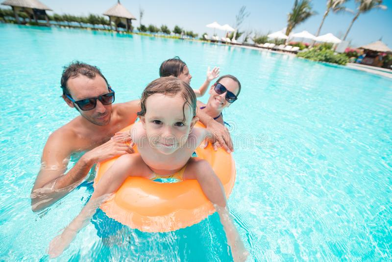 Family in pool royalty free stock photos