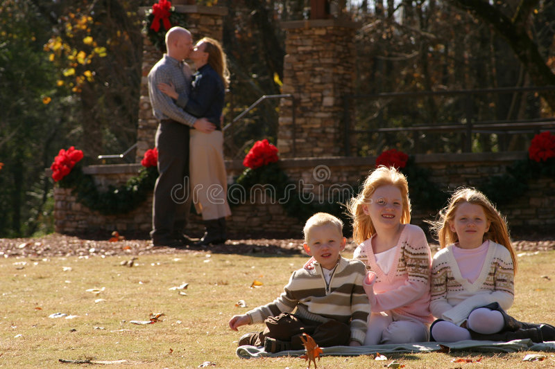 Family portrait. Family posing in on grass for a family portrait royalty free stock photo