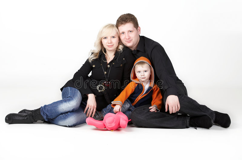 Family portrait. Happy family with baby on the white background royalty free stock image