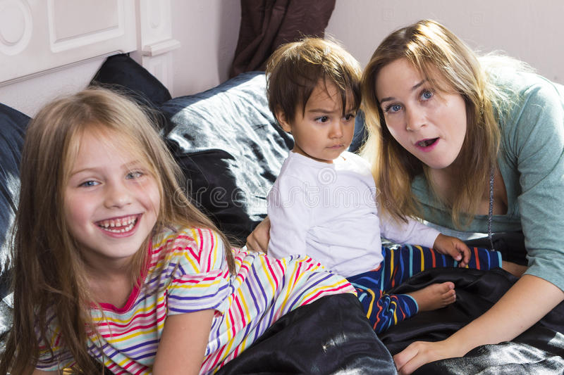 Family portrait in bed at home royalty free stock photography