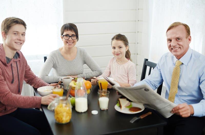 Family Portrait in Cozy Kitchen royalty free stock photos