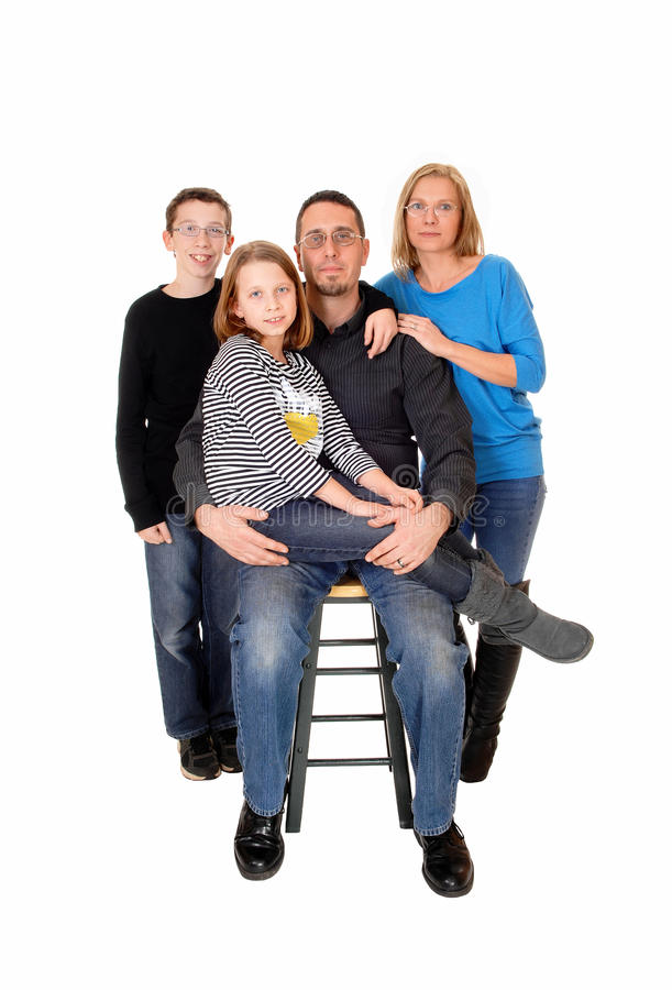 Family portrait of four. A family of four people, mom dad daughter and so, standing isolated for white background royalty free stock photography