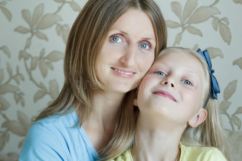 Family portrait of happy mother with her teenage daughter. Family portrait of happy mother with her blonde teenage daughter stock photo