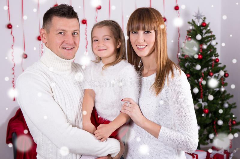 family portrait of happy parents and daughter with Christmas tree royalty free stock photos