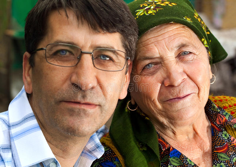 Family portrait - mature son and grandmother stock photos