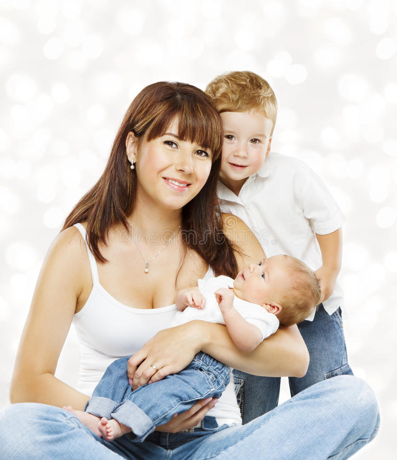 Family Portrait Mother and Baby Children, Mom with Two Kids. Son and Newborn Boy stock photo