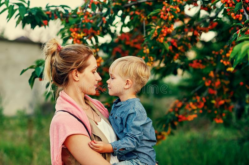Family portrait of mother and son in nature. Mother`s day royalty free stock images