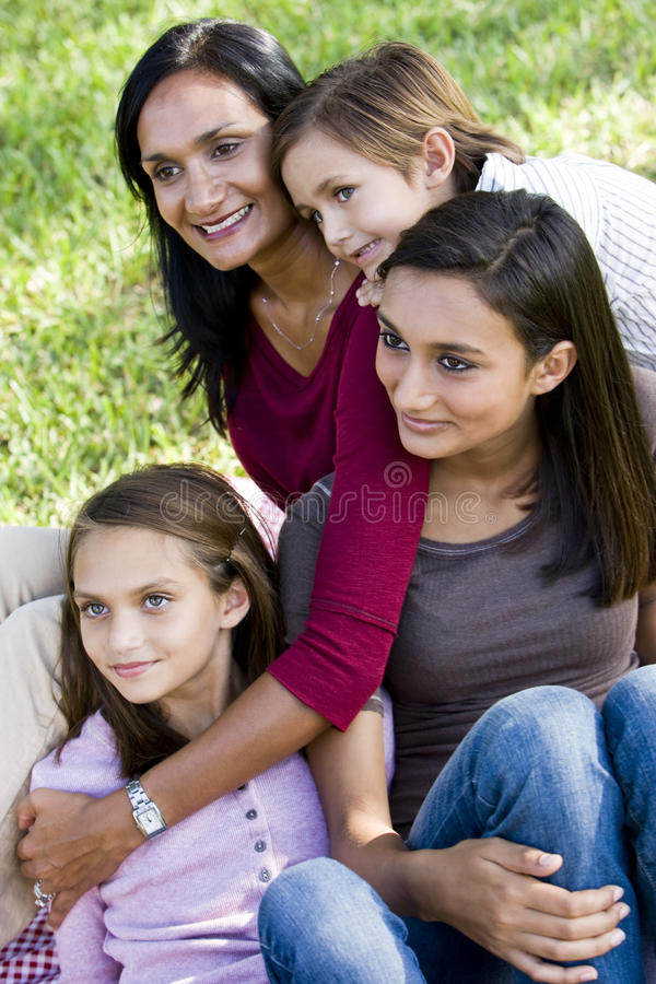 Family portrait, mother with three children