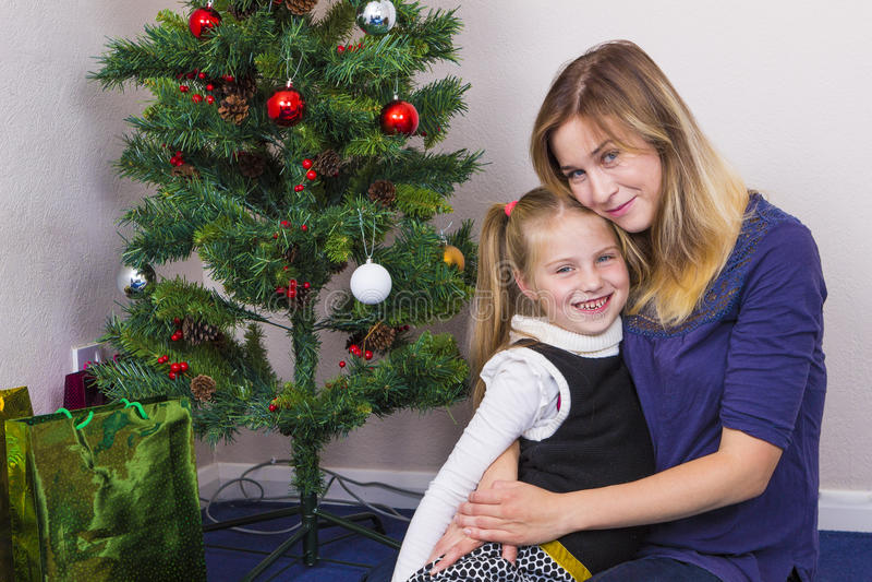 Family portrait near New Year tree royalty free stock image