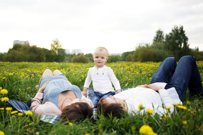 Family. Family Portrait. Young happy Family walking outdoor. Pregnant woman, husband and Child - happy Family having fun stock photo