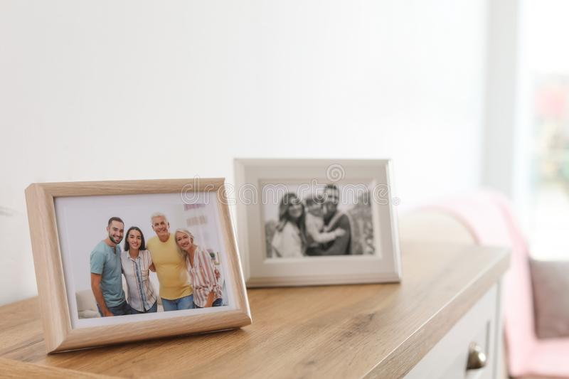 Family portraits in frames on cabinet royalty free stock photo