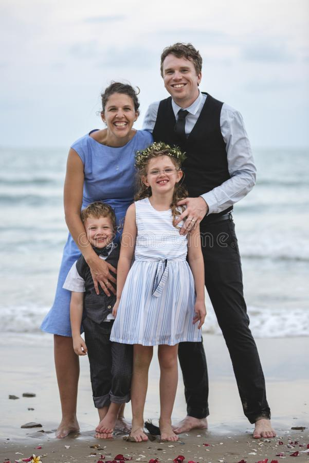Family posing for a group photo at the beach stock photo