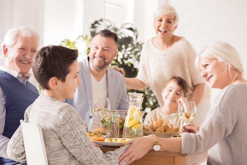 Family praising boy royalty free stock photo