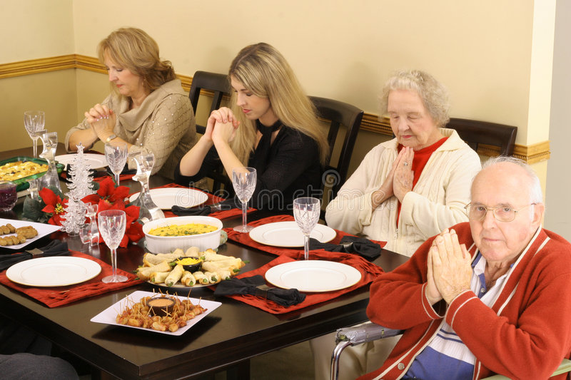 Download Family Praying At Breakfast Royalty Free Stock Photos - Image: 3979698